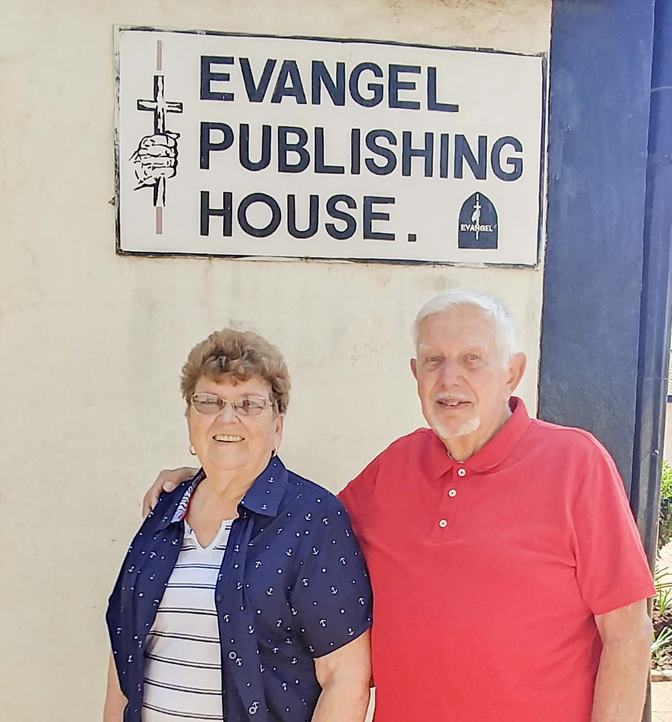 two people outside of the evangel publishing house